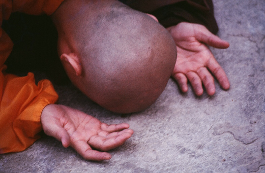 Bowing monk