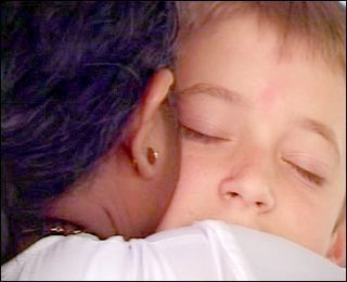 Amma hugging child