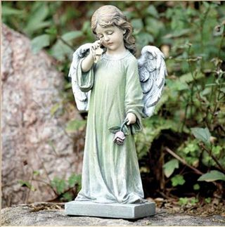 Child angel statue weeping